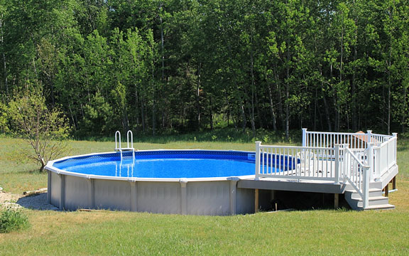 backyard swimming pool with deck