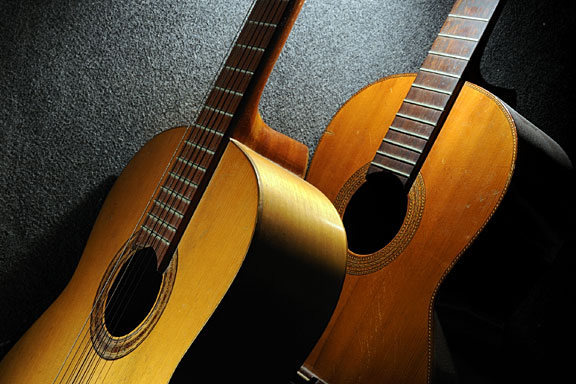 acoustic guitars on a dark surface