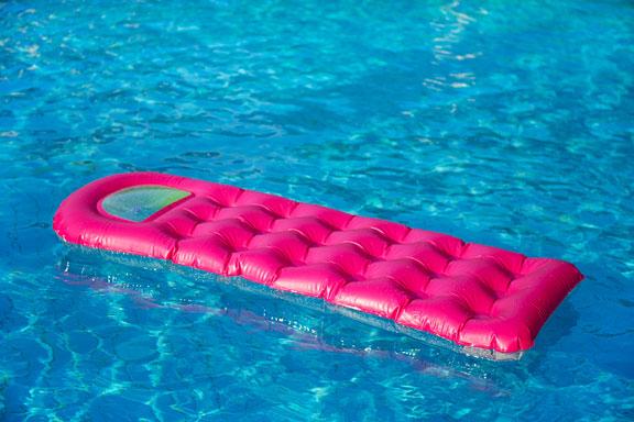 pink air mattress on blue water