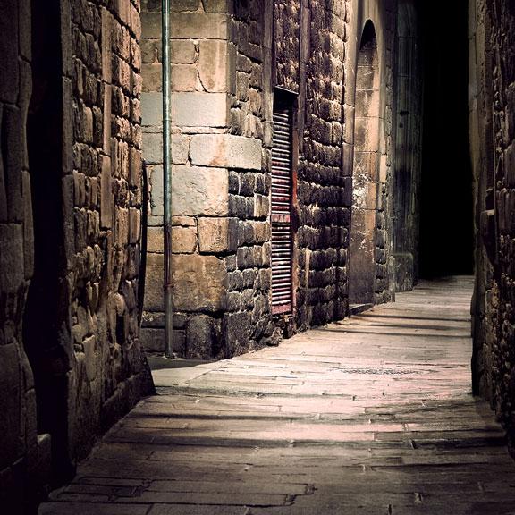 alley between stone buildings