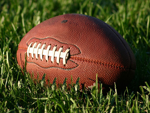 oval-shaped football with white laces