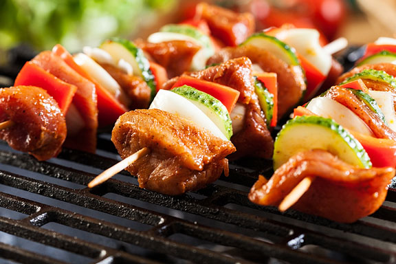 grilling with skewers on a barbecue grill