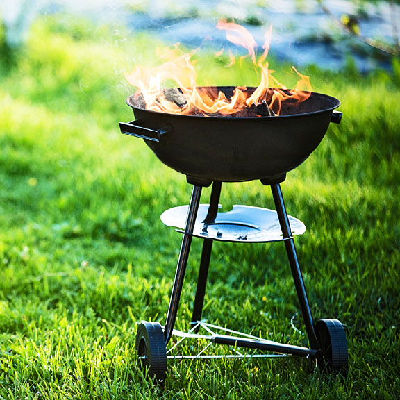 barbecue grill on a backyard lawn