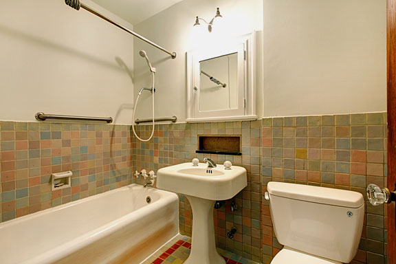 three bathroom fixtures
