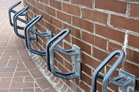 five metal bicycle racks
