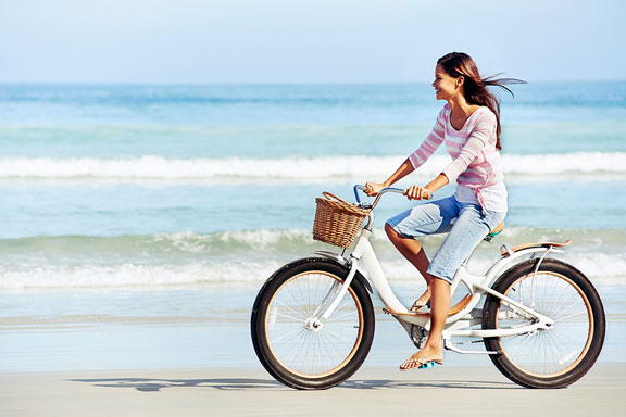 bicycling along a beach