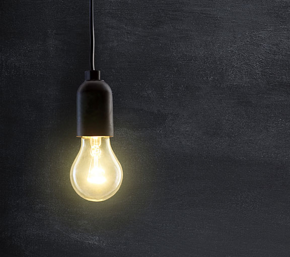 blackboard behind light bulb
