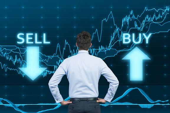 stock broker viewing financial charts