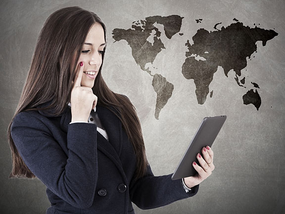 world map and businesswoman with smartphone