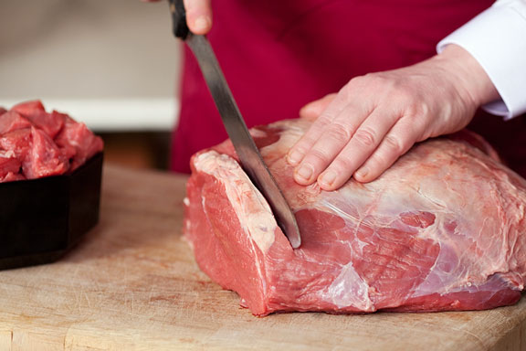 butcher cutting meat