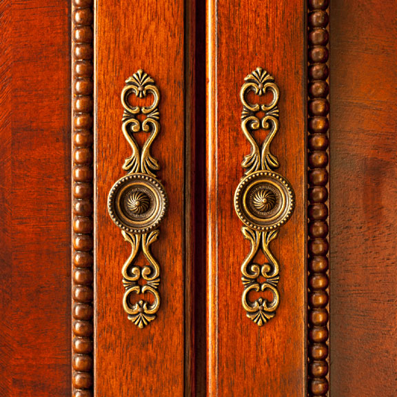 ornate knobs on wood cabinet doors