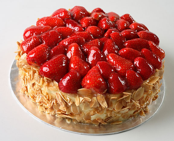 cheese cake with strawberries on top