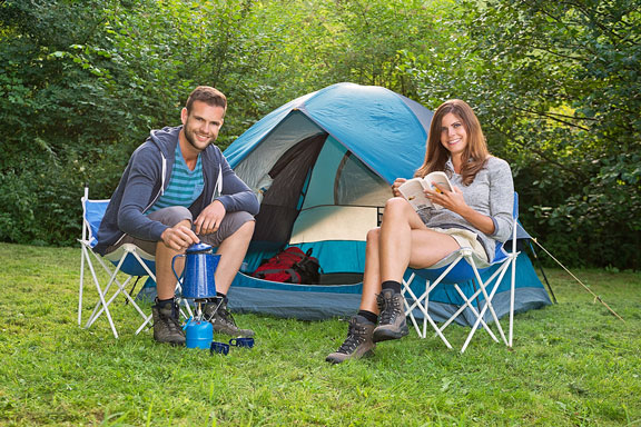 young couple with camping tent