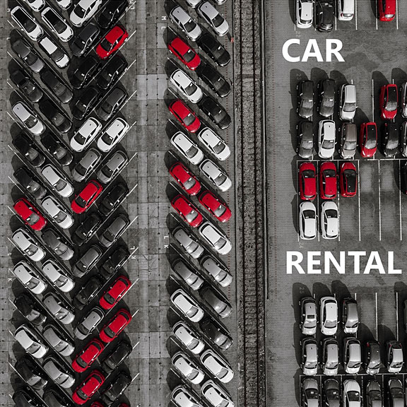car rental lot with many rental cars