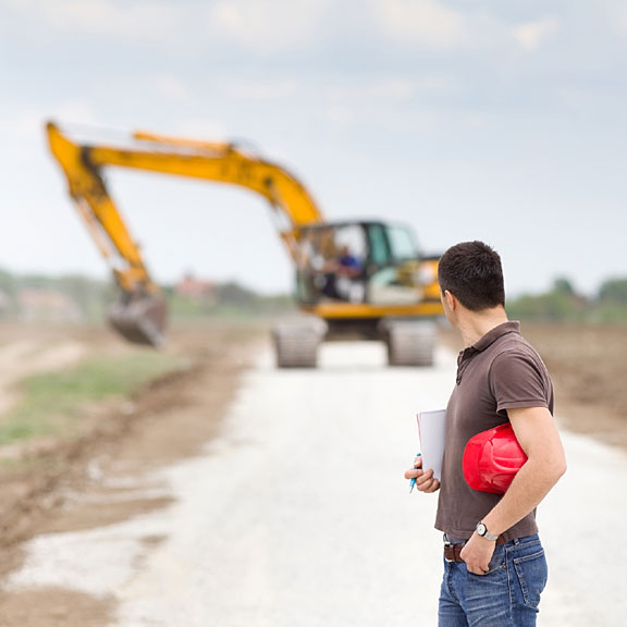 civil engineer standing on a road