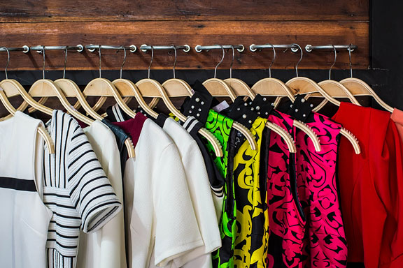 closet with blouses on hangers
