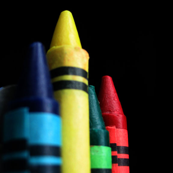 colorful crayons on black