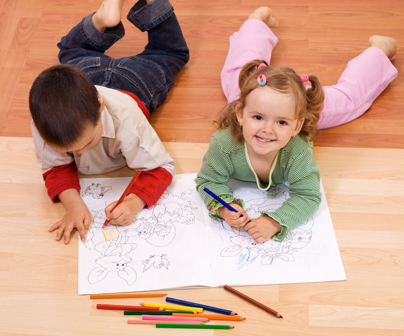 children coloring with colored pencils