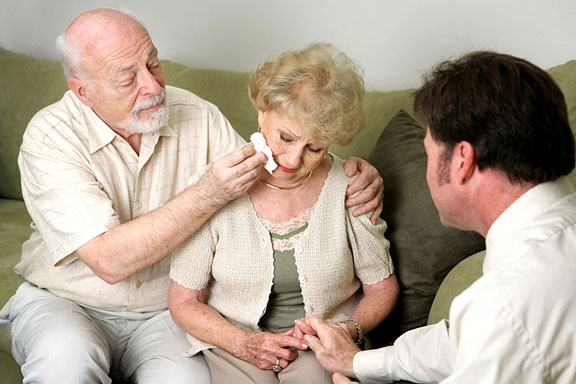 counselor counseling an elderly couple