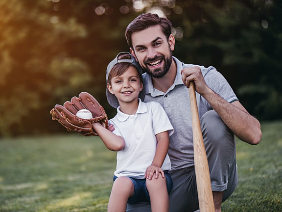 dad and son playing baseball together
