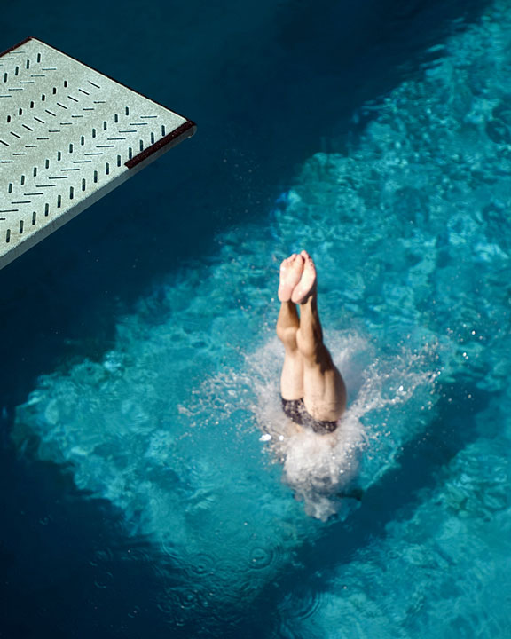 diver diving into a swimming pool