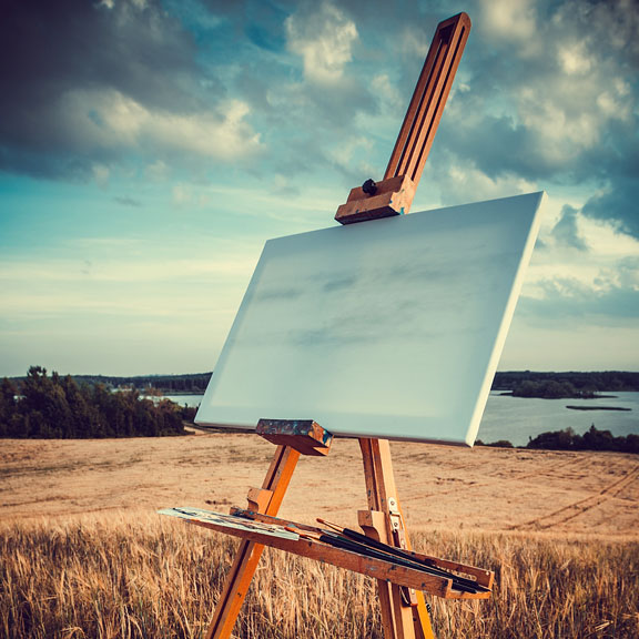 outdoor easel with canvas and paintbrushes