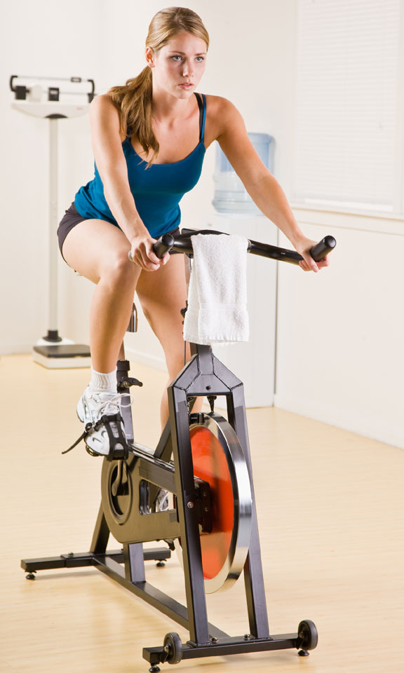 woman riding a stationary bicycle