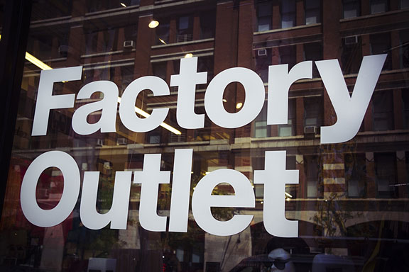Factory Outlet sign on a store window
