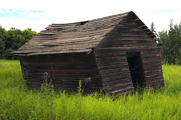 rickety old storage shed on a farm