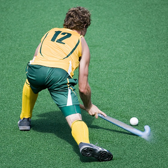 field hockey player with stick and puck