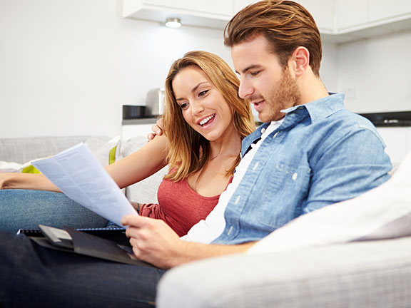 young couple reviewing their finances