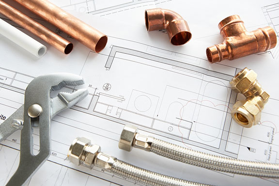 plumbing fittings, tubing, and wrench