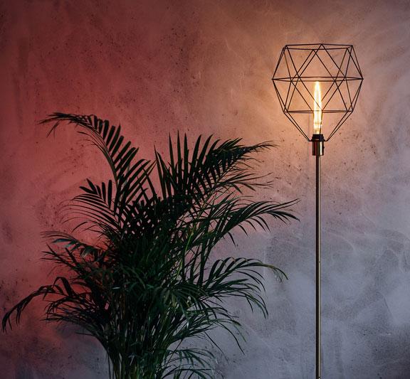 designer floor lamp and greenery