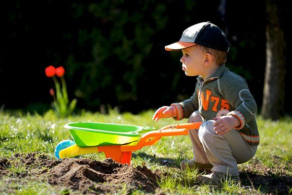 little gardener and wheelbarrow