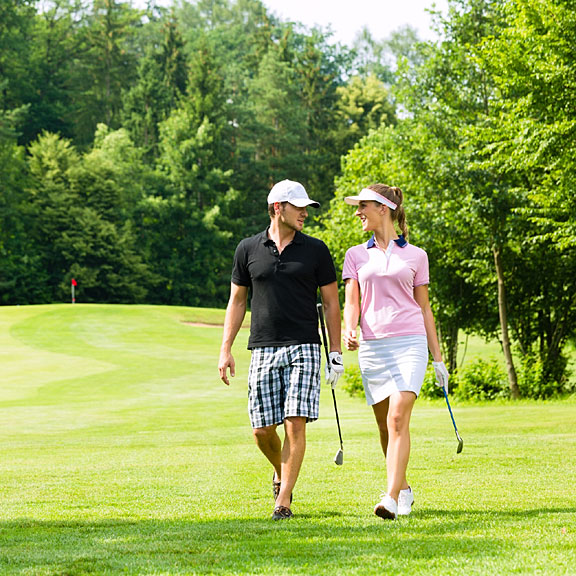 couple walking on a golf course