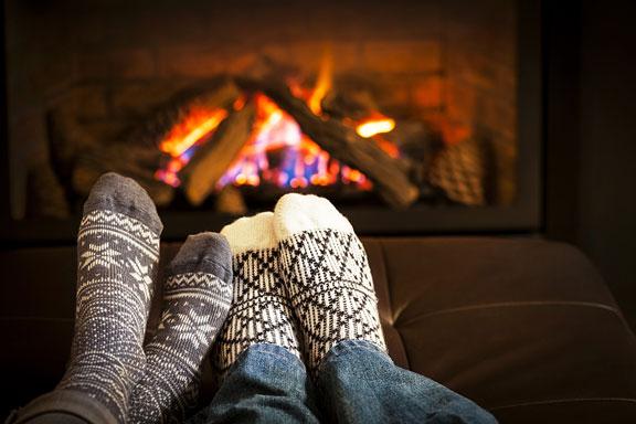 wood fireplace heating a room