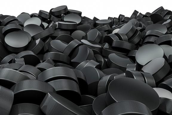 pile of hockey pucks