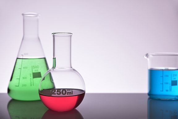 colorful chemicals in glass flasks on a laboratory table