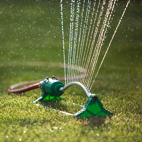 lawn sprinkler watering a lawn