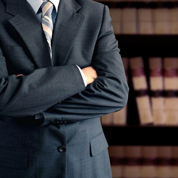 lawyer standing in law library