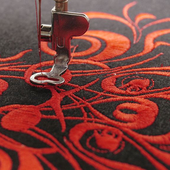 machine embroidering a red flower design