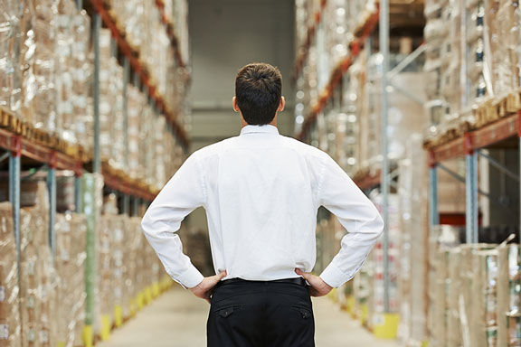 warehouse manager in shirtsleeves