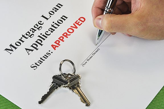 signing an approved mortgage loan