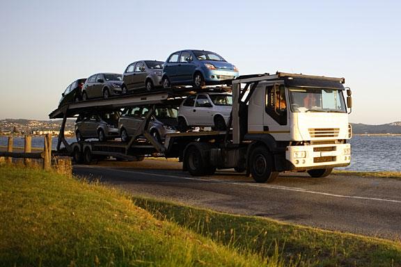 motor vehicles on a transporter truck