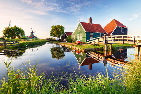 canal and windmill at sunset