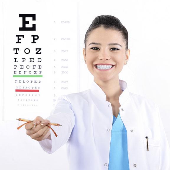 female optician, eyeglasses, and eye chart