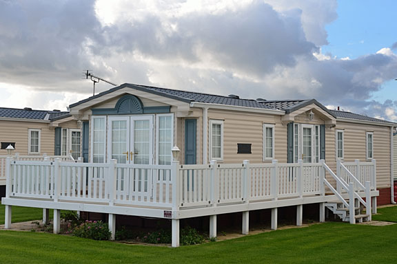 spacious mobile home with raised deck