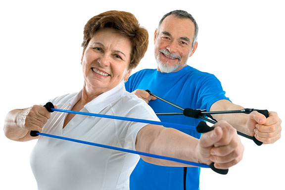 couple exercising with resistance bands