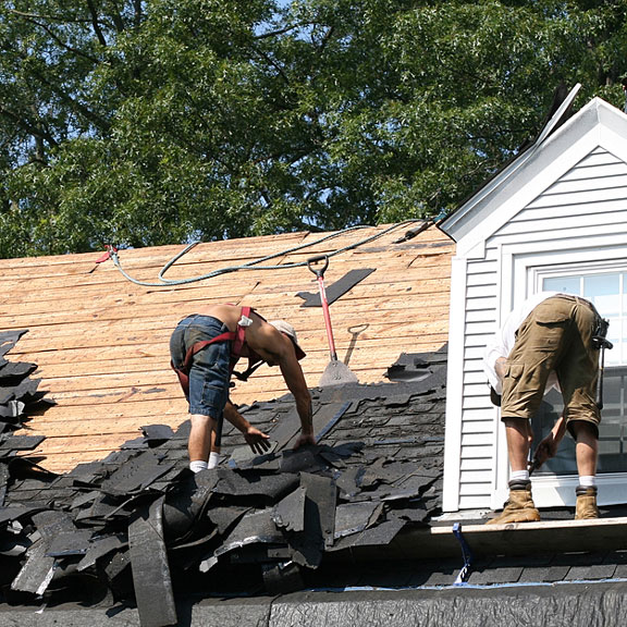 roofers working on a sloping house roof