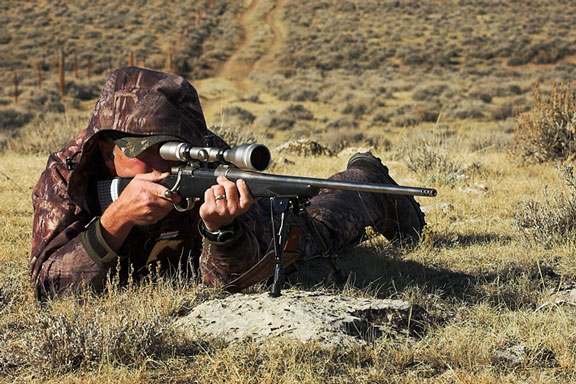 hunter using a hunting scope